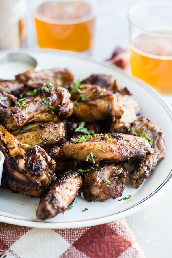 A summer barbecue recipe for Smoked Chicken Wings will take your wing game to new, spectacular heights. Fire up that charcoal smoker; here's everything you need to know to make the best chicken wings ever!