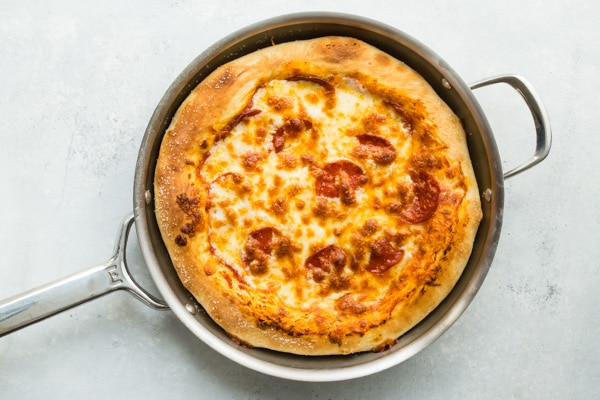This recipe goes out to all the Pepperoni Pizza lovers in the world—you know who you are. This Pepperoni Pizza Recipe is a perfect homemade pizza that will make you think twice about delivery, featuring lots and lots of your favorite thing: pepperoni.