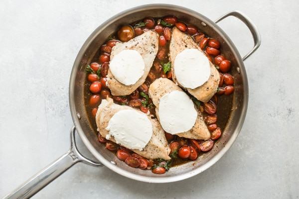 This is a chicken recipe you'll return to again and again; no matter when you make it, tomato and basil Caprese Chicken tastes like the height of summer. This recipe uses burst cherry tomatoes and a quick balsamic pan sauce; melted fresh mozzarella makes it irresistible. It's one of the best one pot dinners you'll ever have.