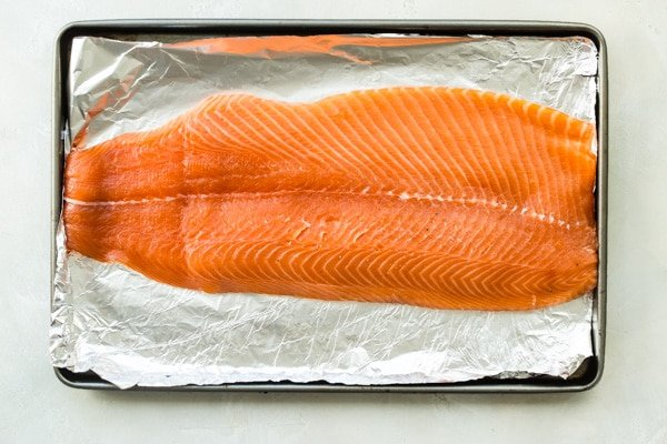 Salmon before being smoked set on foil.