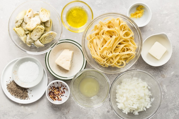 An overhead shot of artichoke pasta ingredients.