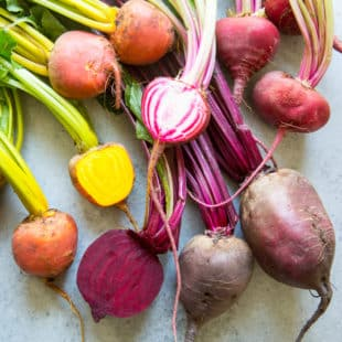 An overhead shot of various colorful beets.