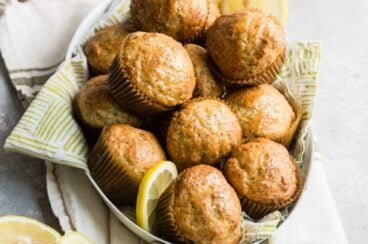 Lemon poppyseed muffins in a white dish.
