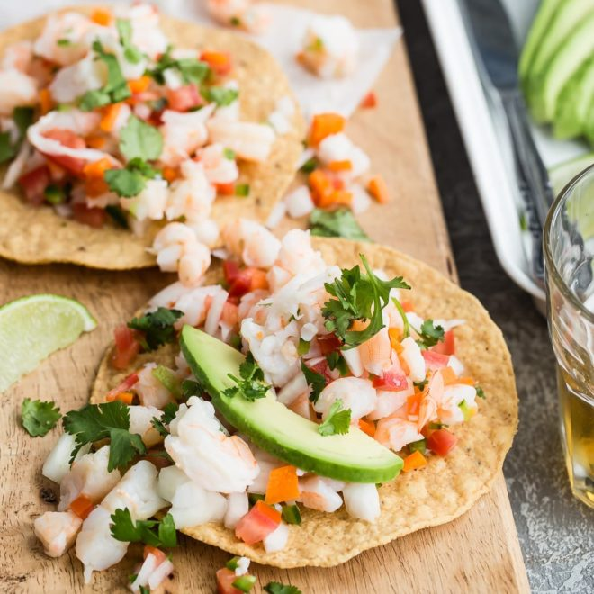 Shrimp ceviche on a wood cutting board.