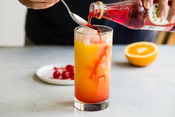 Of all the classic cocktails, a Tequila Sunrise has to be the prettiest of them all. This picture perfect cocktail was made for beaches, poolsides, brunches, and the cutest tiny paper umbrellas you can find.