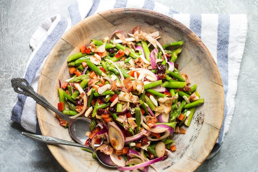 Asparagus salad in a wooden bowl.
