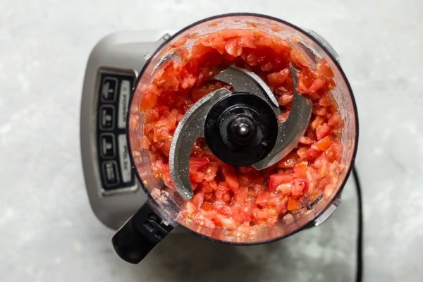 Tomatoes in a food processor.