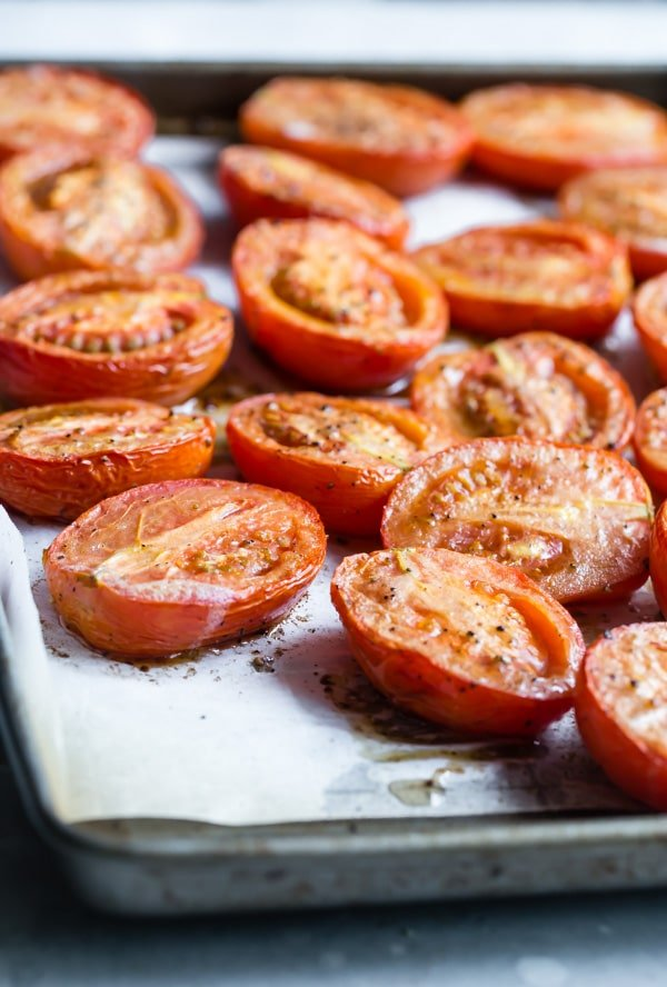 Oven roasted tomatoes are delicious on their own or added to last-minute pastas, salads, or sandwiches. Here's How to Roast Tomatoes, transforming any ordinary grocery store tomato into a truly gourmet ingredient.