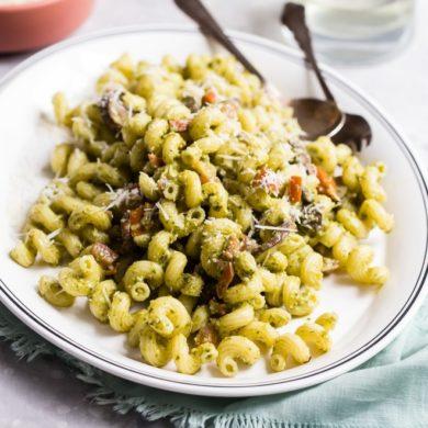 Pesto cavatappi on a white platter.