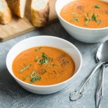 Roasted tomato soup in white bowls.