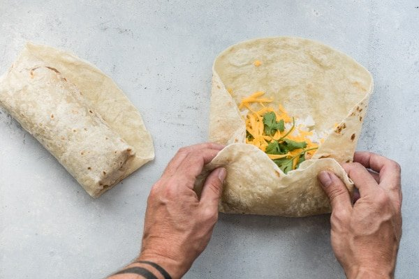Leftover chili and cheese gets rolled up tight into a flour tortilla for the ultimate midnight snack or quick lunches on the go.