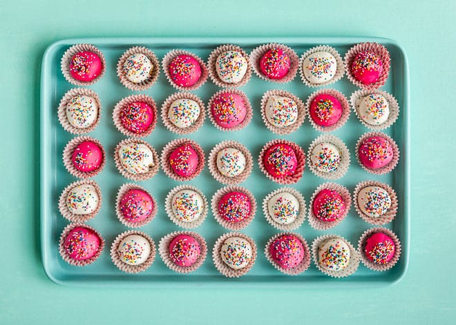 With the popularity of both my Lemon Cookie Balls and Homemade Pink and White Circus Cookies, I wanted to make another fun mashup of the two. This Circus Cookie Ball Recipe is so yummy. I haven't met anyone who isn't immediately charmed by these tasty little treats.