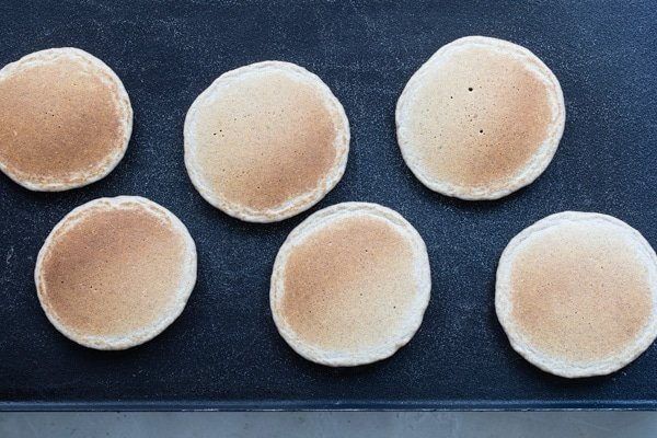 An overhead shot of browned pancakes on a griddle.