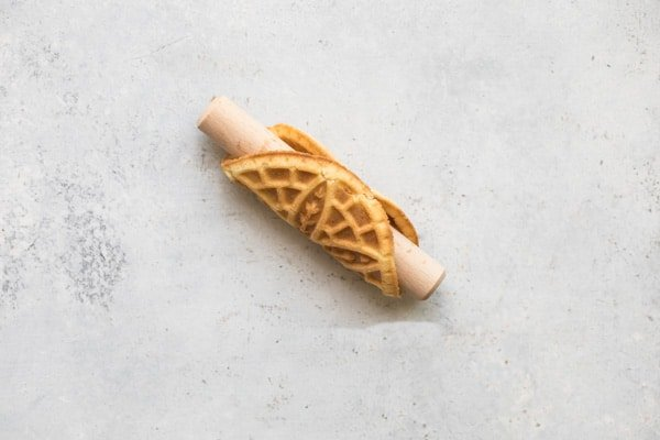 Crunchy on the outside, with a delicately sweet and creamy center, this recipe for Mock Italian Cannoli with Pizzelle cookies is nothing short of heavenly. Your Sicilian grandmother would approve.