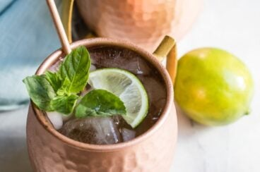 The best Moscow mule in a copper mug with a lime.