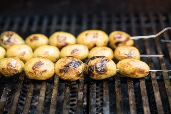 Grilled potatoes on a grill.