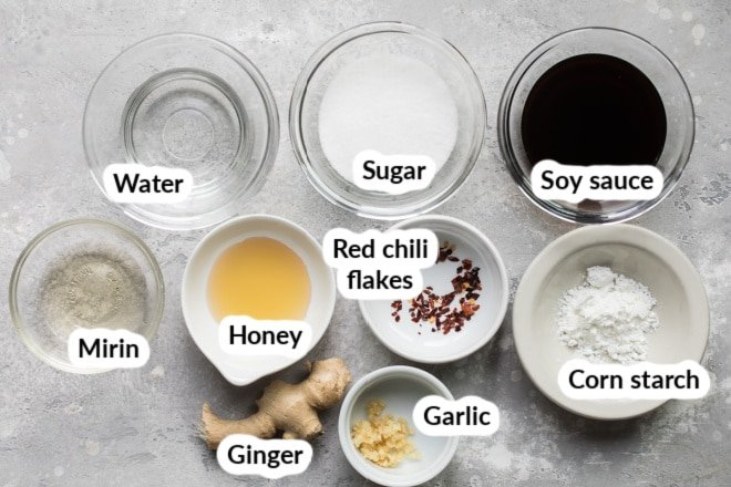 The ingredients for teriyaki sauce arranged in bowls.