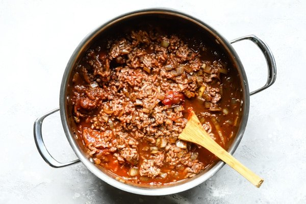 Cincinnati chili cooking in a silver pot.