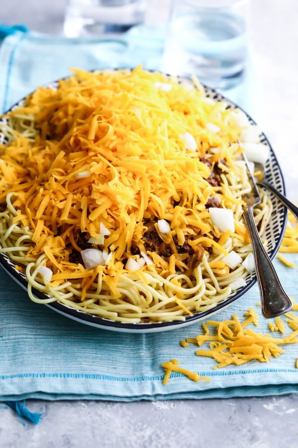 Cincinnati chili on a black and white serving platter.