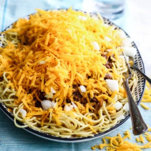 Cincinnati chili in a black and white serving dish.