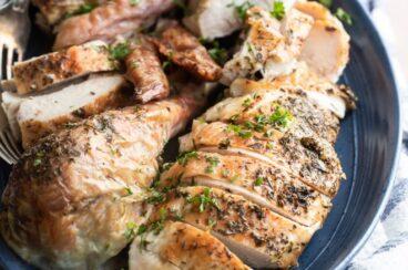 Make ahead roasted turkey on a blue serving platter.