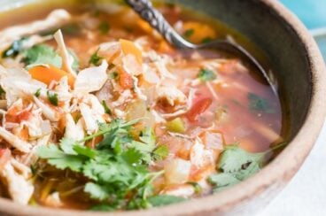 Mexican Chicken Soup in a bowl topped with fresh cilantro.