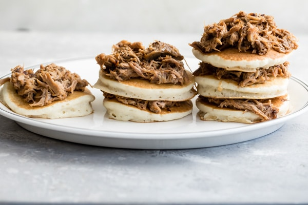 Fluffy, made-from-scratch pancakes layered with tender BBQ pulled pork and drenched in a whiskey maple syrup is a delicious, over-the-top combination you won't believe…until you try it.