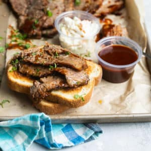 Slow cooker beef brisket slices on toast.