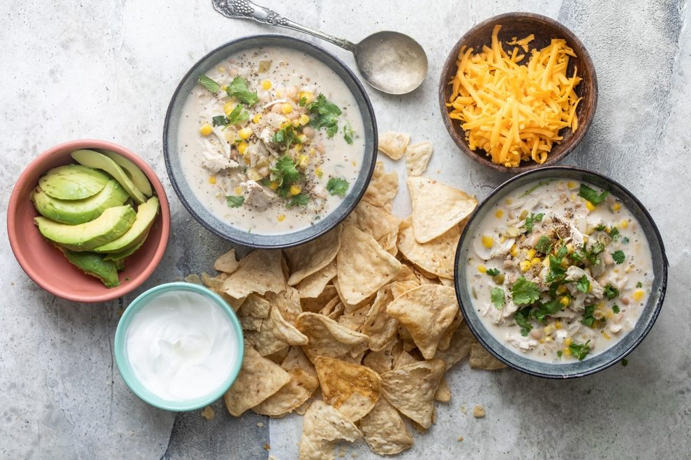 Slow Cooker White Chicken Chili is a hearty one-pot wonder that's perfect for the fall. Provide a range of colorful, spicy toppings and let everyone serve you.
