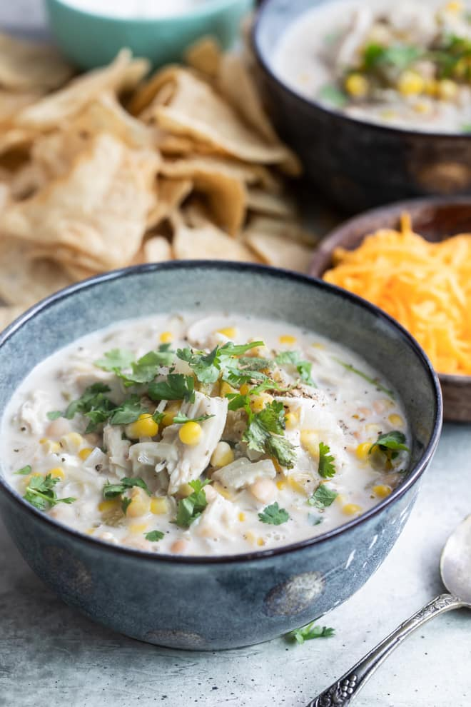 Slow Cooker White Chicken Chili is a hearty, one-pot wonder that's perfect for fall. Set out a bunch of colorful, zesty toppings and let everyone help themselves.