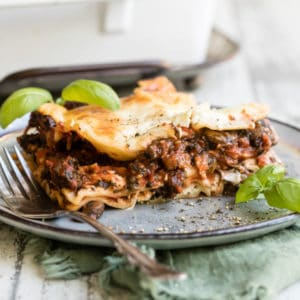 Vegetable lasagna on a blue plate.