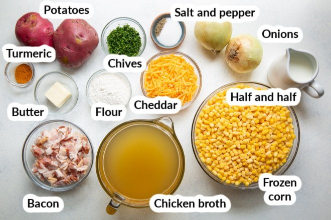 Corn chowder ingredients in bowls and labeled.