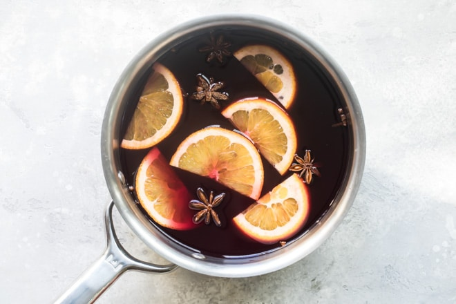 An overhead shot of mulled wine in a silver pot.