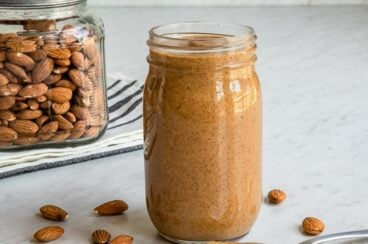 Almond butter in a clear jar.