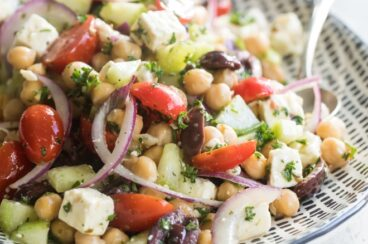 Chickpea salad on a black and white serving platter.