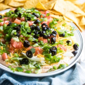 Easy taco dip on a white platter.