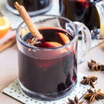 Mulled wine in a clear glass mug.