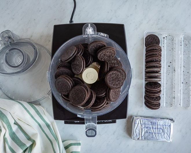 An overhead shot of whole Oreos in a food processor.