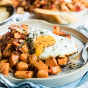 Sweet potato hash on a blue plate.