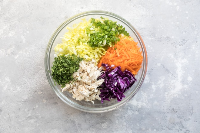 An easy recipe for Chinese Chicken Salad that's as delicious as it is healthy. Say hello to a rainbow of crunchy veggies, chicken, and noodles tossed in a gingery dressing that will knock your socks off.