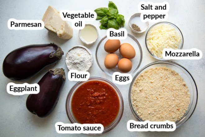 Labeled eggplant parmesan ingredients in bowls.