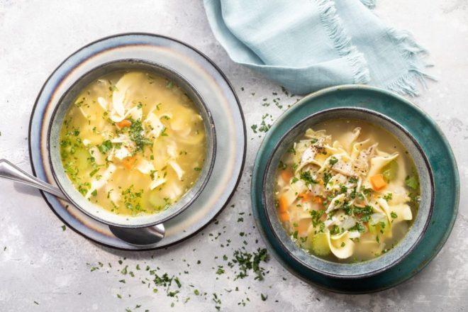 Leftover turkey noodle soup in a blue bowls.