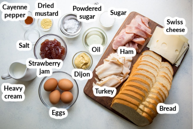 Labeled monte cristo ingredients in bowls.