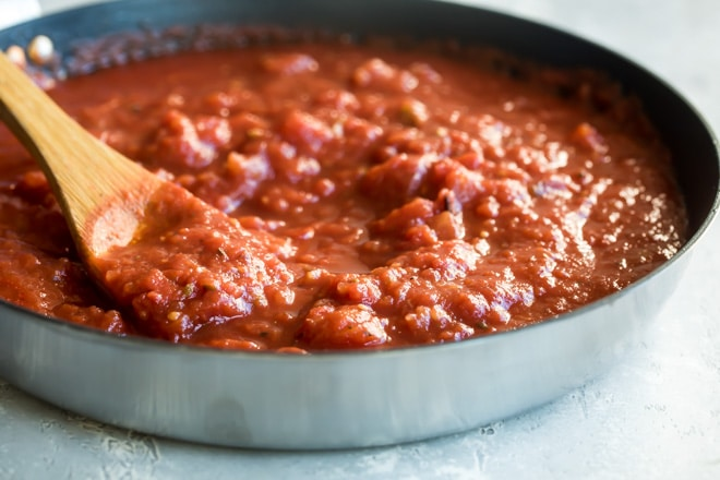 Quick tomato sauce in a black sauce pan.