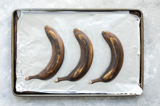 Baked bananas on a baking sheet.