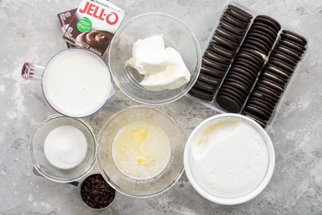 Chocolate lasagna ingredients in various bowls.