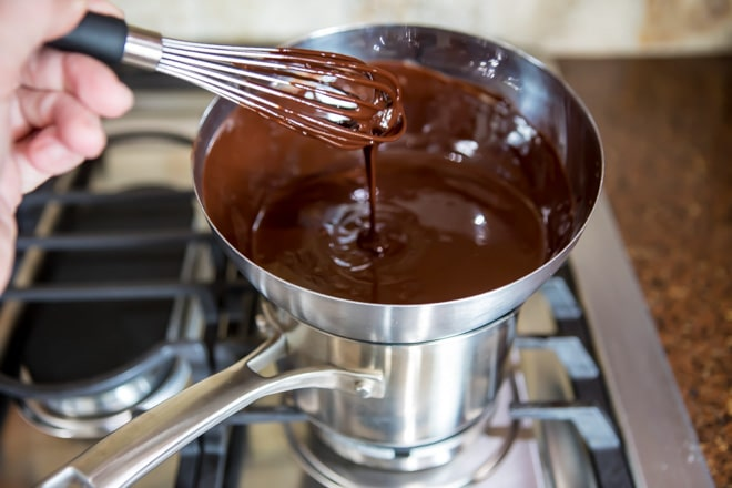 Chocolate and butter melted together on a stove top.