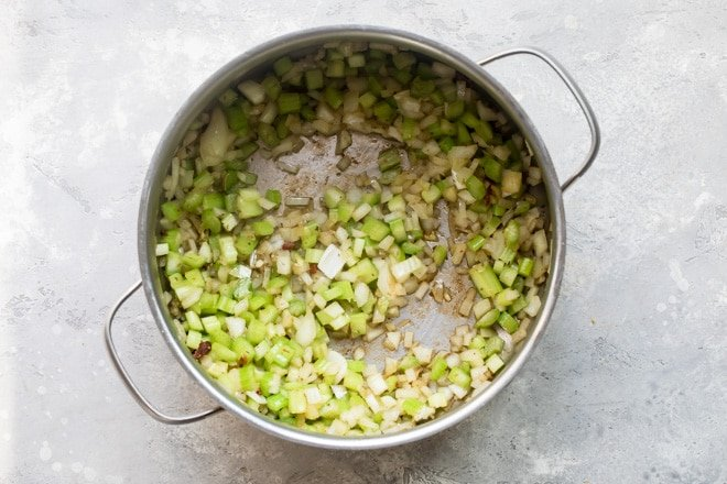 Chopped vegetables cooked in a silver pot.