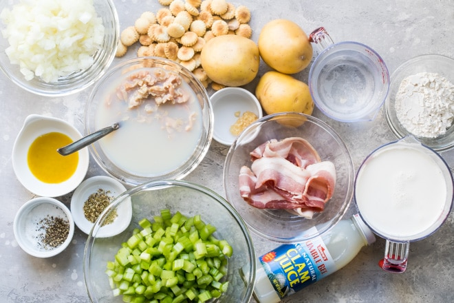 New England clam chowder ingredients in various bowls.