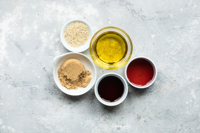 Sesame dressing ingredients in various bowls.